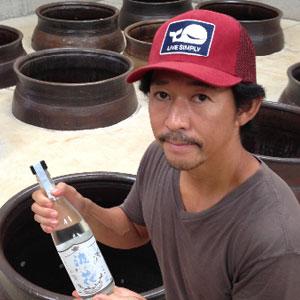 Ken Hirata holding a bottle of Sochu