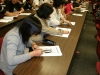 Students sitting at desks looking at handouts